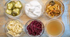 glass bowls containing fermented foods