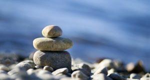 meditation stones against ocean background