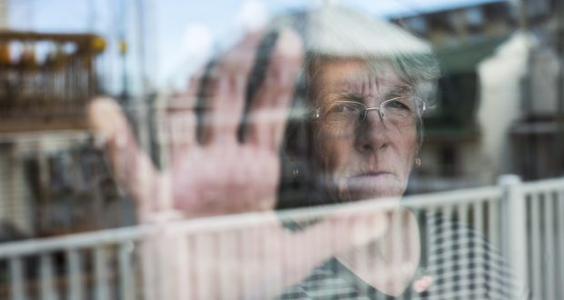 woman with alzheimers and diabetes looking out the window