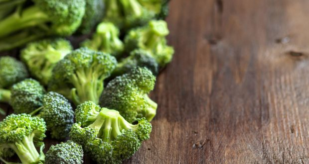 fresh broccoli on wooden table