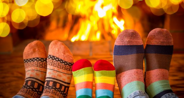 cold feet in front of fire