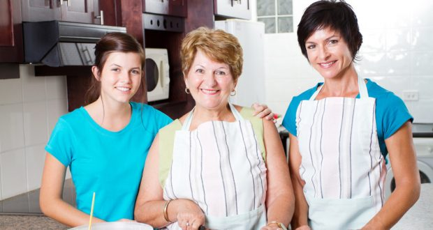Three generations cooking together at home