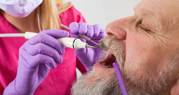 Man having his teeth examined