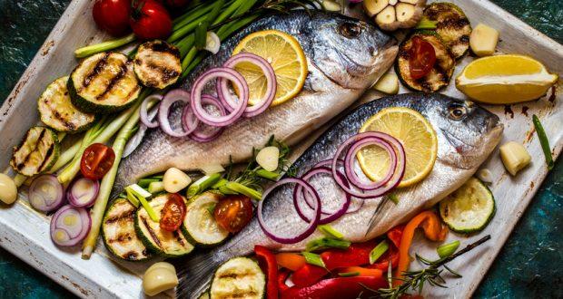 Whole fish baked with veggies and lemon