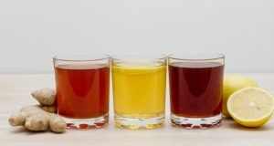 A selection of colorful kombuchas in clear glasses
