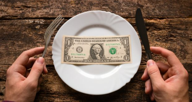 dollar bill on plate