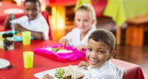 Children eating together at school