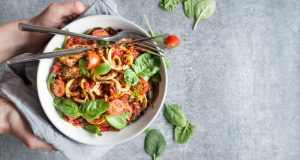 Bowl of zucchini noodles with tomatos