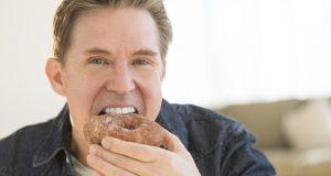Man eating a doughnut