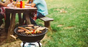 Barbecue grill and picnic table outside