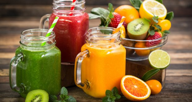 Glass jars filled with fruit juices