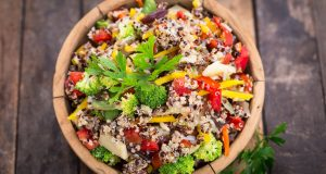 fresh quinoa salad in wooden bowl