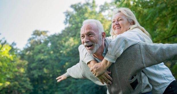 Happy senior couple having fun together outside