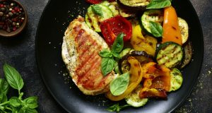 Plate of grilled chicken and roasted vegetables