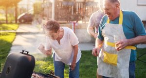 Family having fun grilling outside together