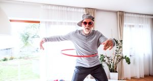 Senior man having fun with hula hoop