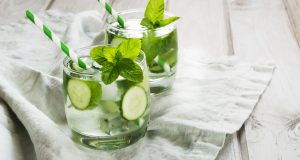 glasses of water with cucumber and mint