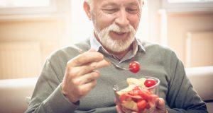 Man enjoying bowl of veggies
