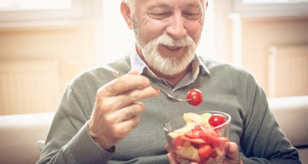 Man enjoying bowl of veggies