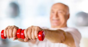 Older man lifting small weights