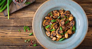 Bowl of mushrooms with herbs
