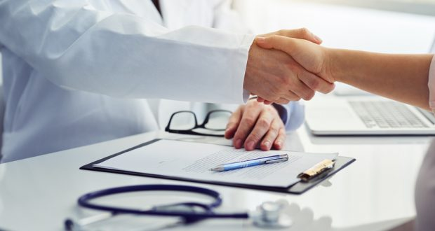 Physician shaking hands with patient