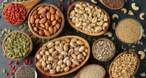 Selection of nuts and seeds in wooden bowls