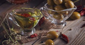 Olive oil and olives in glass bowls