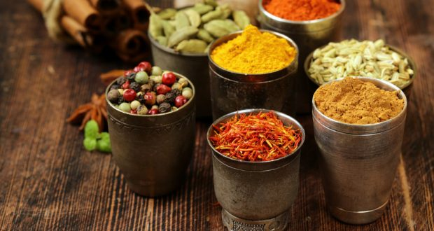 small pots of colorful spices