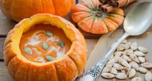 pumpkin soup served inside of a pumpkin