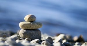 meditation stones against ocean background