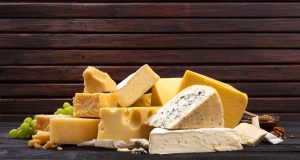 Selection of cheeses on wooden board