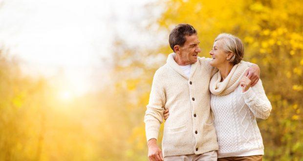 couple walks outside in autumn