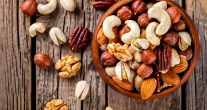 Mixed nuts in bowl on wodoen table