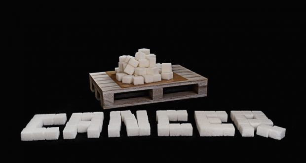 Sugar cubes spelling out the word cancer