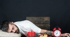 Man asleep at table after meal