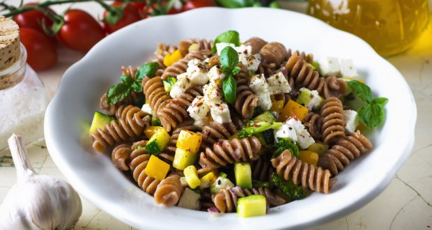 whole wheat pasta noodles with veggies and cheese