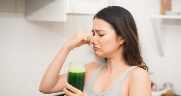 Woman does not like drinking health shake